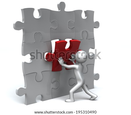 Fitting the Missing Piece Figure fits in the Missing last piece of puzzle - stock photo