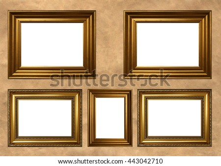 Five antique golden frames with white copy space on vintage background - stock photo