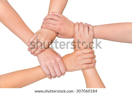 Five arms with hands of girls holding each other joining on white background - stock photo