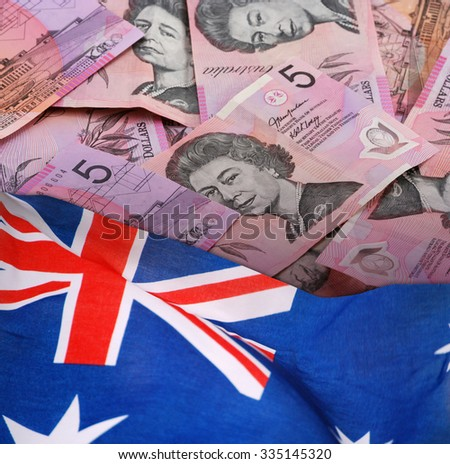 Five Australian Dollars Banknotes with Australian Flag.