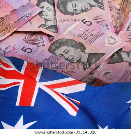 Five Australian Dollars Banknotes with Australian Flag. - stock photo