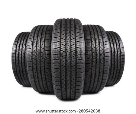 five automobile black rubber tires isolated on white background