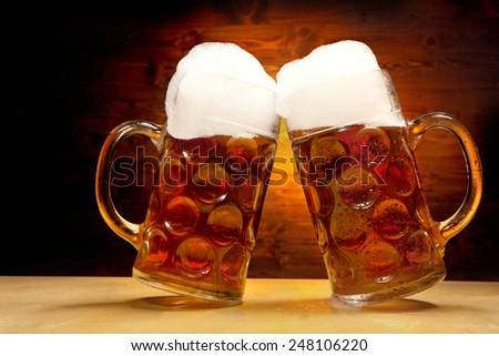 Five Big Glasses of Beer Standing on the wooden Table on the Wooden Background - stock photo