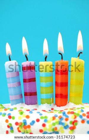 Five birthday candles on blue background - stock photo