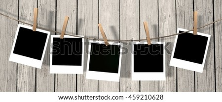 five blank instant photos hanging on the clothesline - 3d rendering
