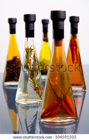 Five bottles of assorted olive oil bottles