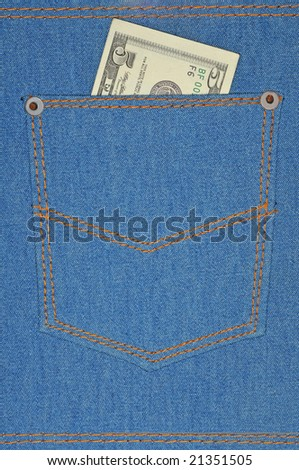 five bucks at back pocket at jeans fabric background