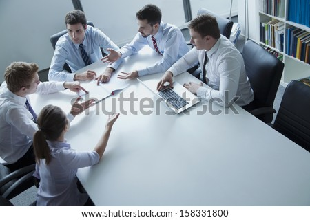 Five business people having business meeting at the table - stock photo