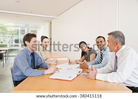 Five businesspeople in a meeting - stock photo