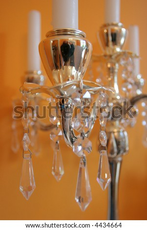 Five candles on a golden candle holder - stock photo