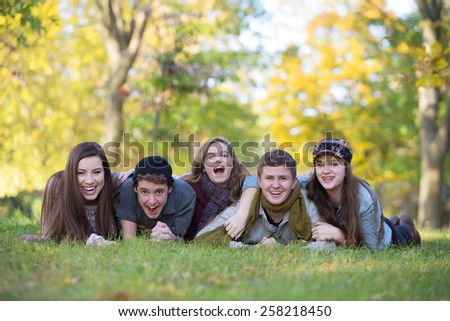 Five caucasian teenagers enjoying the outdoors together - stock photo