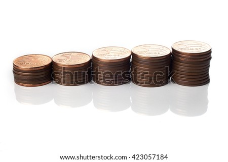 Five cents coin piles of brazilian coins (money) on white background