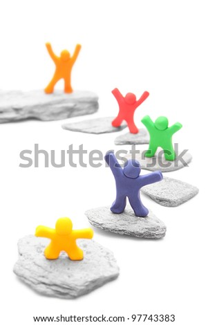 five cheerful plasticine people sharing different levels on stepping stones - team career concept - isolated on white - stock photo