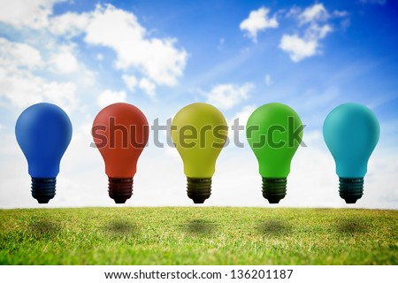 Five colored light bulb in the air against sky background