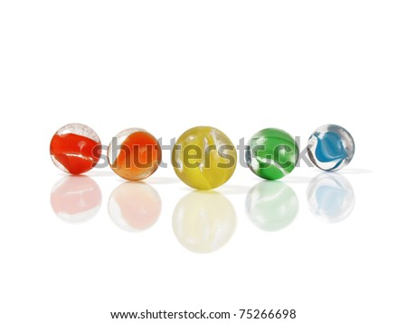 Five colorful marbles isolated and reflected on white - stock photo