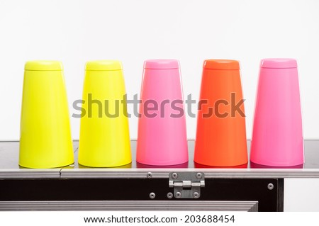 Five colorfull shakers standing on the bar - stock photo