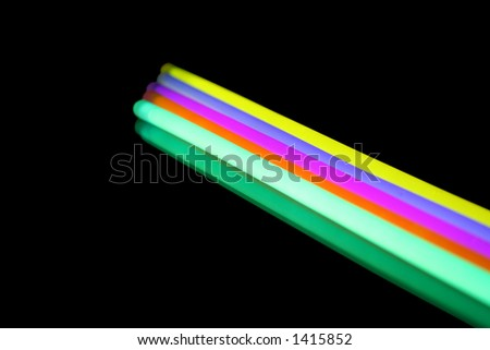 Five coloured light sticks isolated on black with reflection