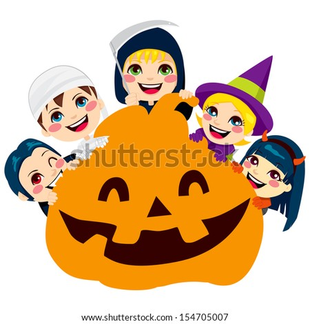 Five cute children in scary monster costumes holding a big Halloween pumpkin face