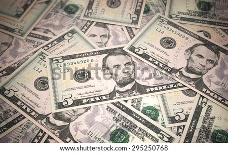 Five dollar banknotes stacks close-up (depth of field) - stock photo