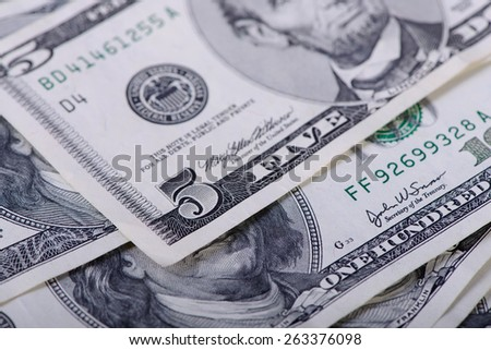 five dollars banknotes as a background close-up - stock photo