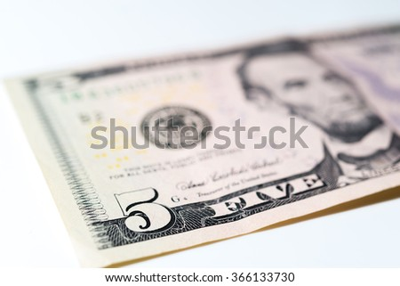 Five dollars bill. Close-up on 5 dollars bill on white background. - stock photo