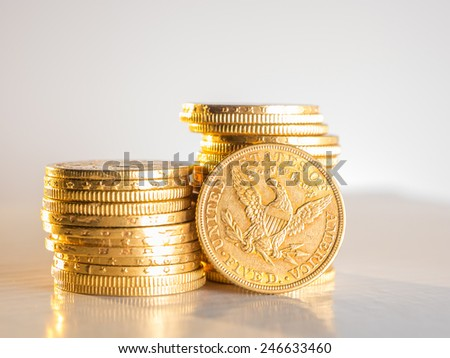 Five Dollars gold coins USD - stock photo