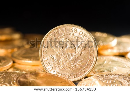 Five Dollars gold coins USD shallow depth of fiels