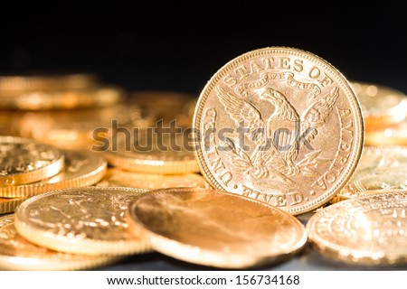 Five Dollars gold coins USD shallow depth of fiels - stock photo