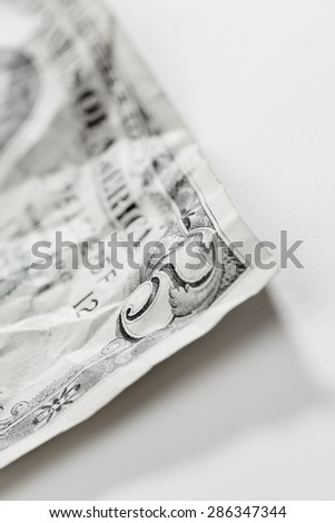Five dollars isolated on white background