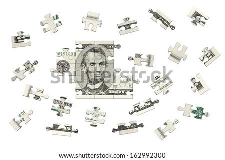 Five dollars jigsaw - stock photo