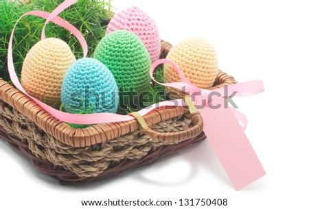 five easter eggs in basket with pink band. Isolated on white background. Eggs crochet.