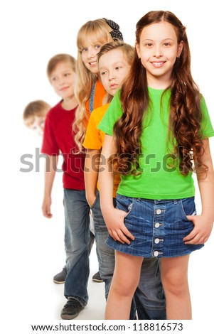 Five eight years old kids both boys and girls with smile on their faces standing in a line