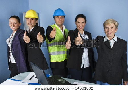 Five engineers team give thumbs up and smiling in a office showing successful in business - stock photo
