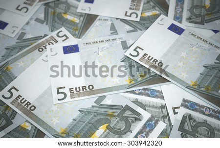 Five euro banknotes stacks (depth of field) - stock photo