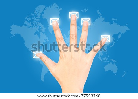 Five fingers pressing mail in world wide. - stock photo