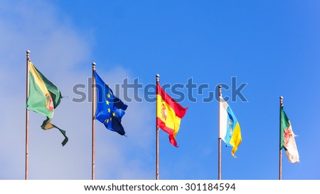 Five flags isolated on blue sky