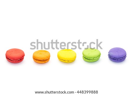 Five french colorful macarons in the row, isolated on white