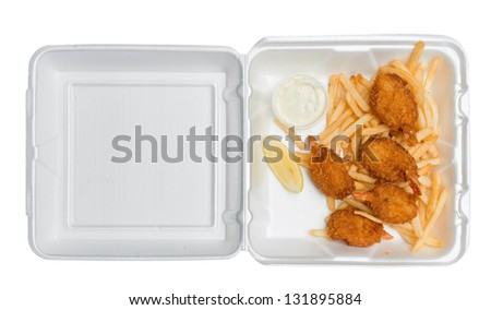 Five fried shrimp, some french fries, a lemon wedge and tartar sauce in an open takeout box from a fast food restaurant. Isolated on a pure white background. Photographed from directly above. - stock photo