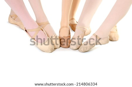 Five Girls point their ballet slippers together in the middle of class. - stock photo