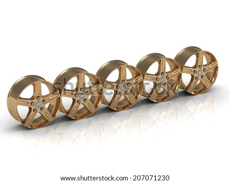 Five golden disks (rims) from car are put in one row on white background - stock photo