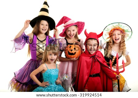 Five Happy Children in Halloween Costumes of Witches, Demon and Princess. - stock photo