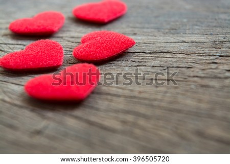 Five hearts on wood background