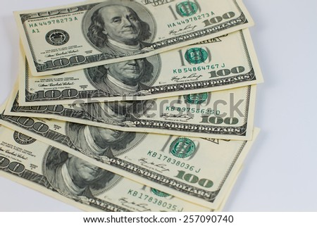Five hundred dollar bills lying on a white background. - stock photo