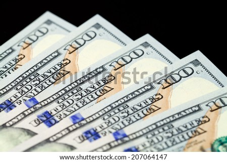 Five hundred dollars isolated on black background