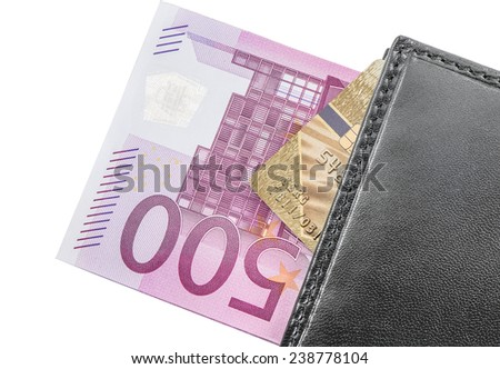 Five hundred euro banknotes and credit card inside the purse on white background.  - stock photo