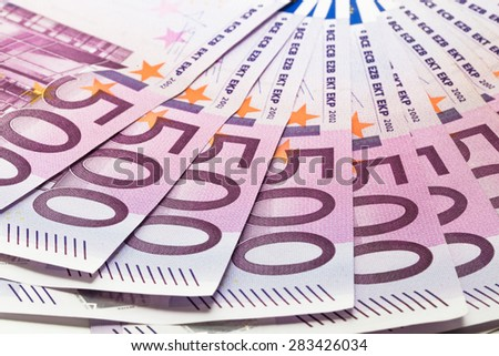 five hundred euro banknotes in raw - stock photo