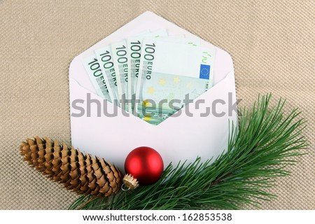 Five hundred euro money in envelope with Christmas deco, close up - stock photo