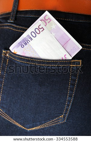 five hundred euros in his pocket jeans - stock photo