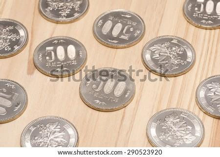 five hundred yen on wooden table - stock photo