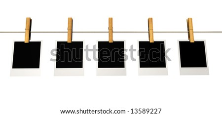 Five instant photo frames on washline isolated on white - 3d render - stock photo